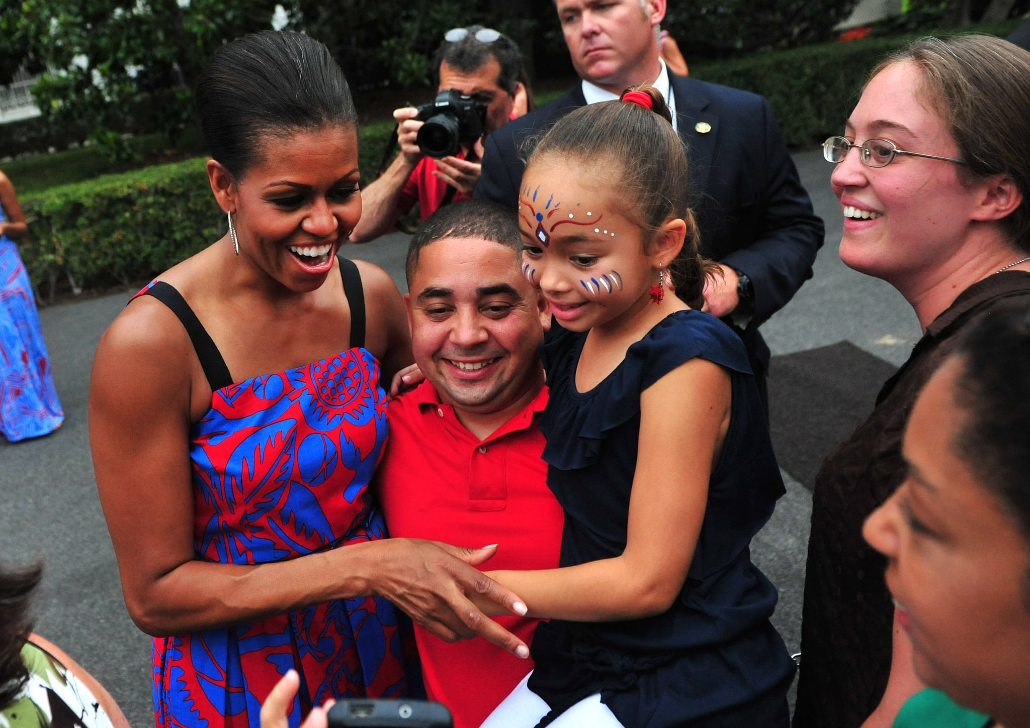 First Lady Michelle Obama hugged it out at a BBQ for White House staff and servicemen and women in 2011.