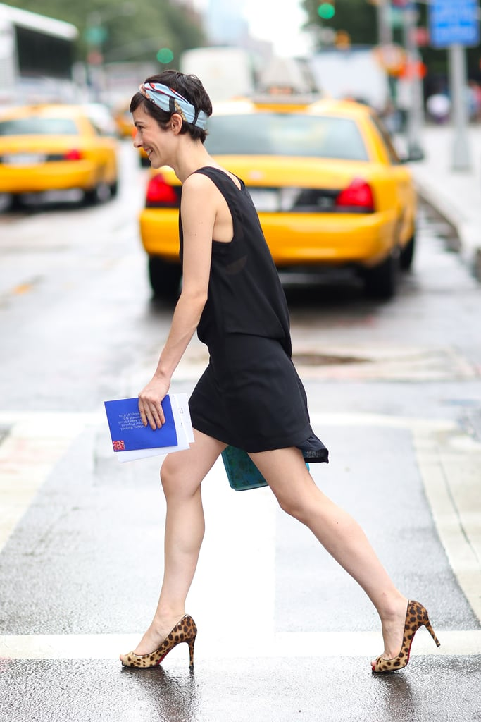Further the interest of an LBD with a head scarf and a brightly hued clutch. Source: Greg Kessler