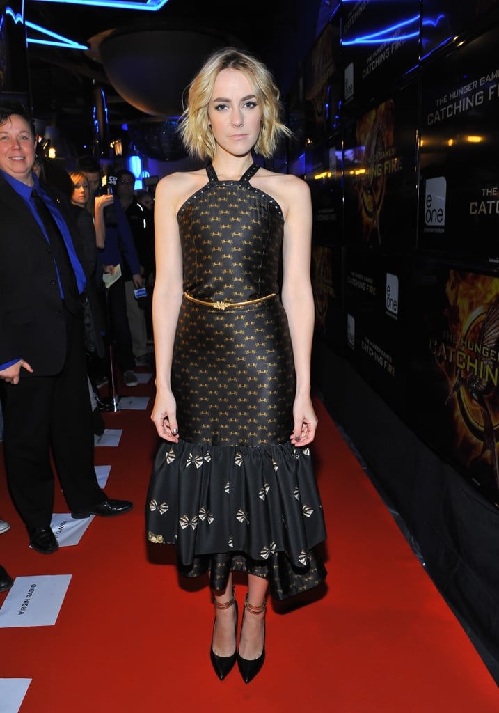 For the Toronto premiere, Jena Malone wore a striking black-and-gold patterned dress by designer Dora Abodi.