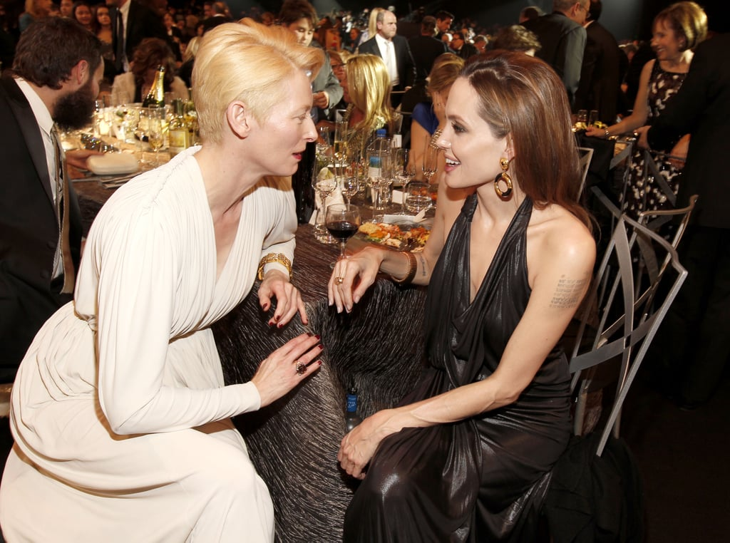 Angelina and her tablemate Tilda Swinton chatted over dinner.