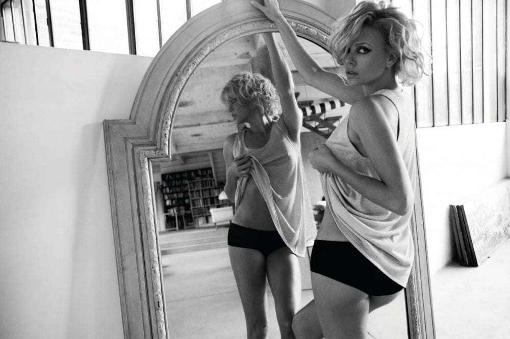 Charlize Theron struck a sultry pose for the July 2010 issue of Elle France.