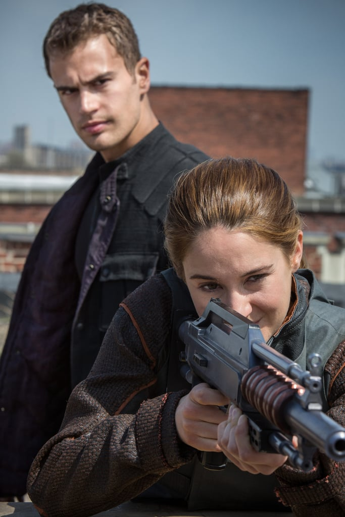 Four looks on as Tris works on her target practice.