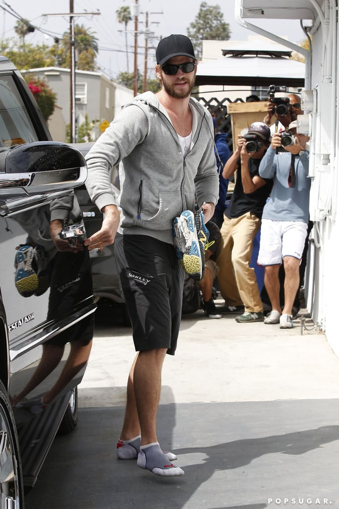 Liam Hemsworth got out of his car in socks.