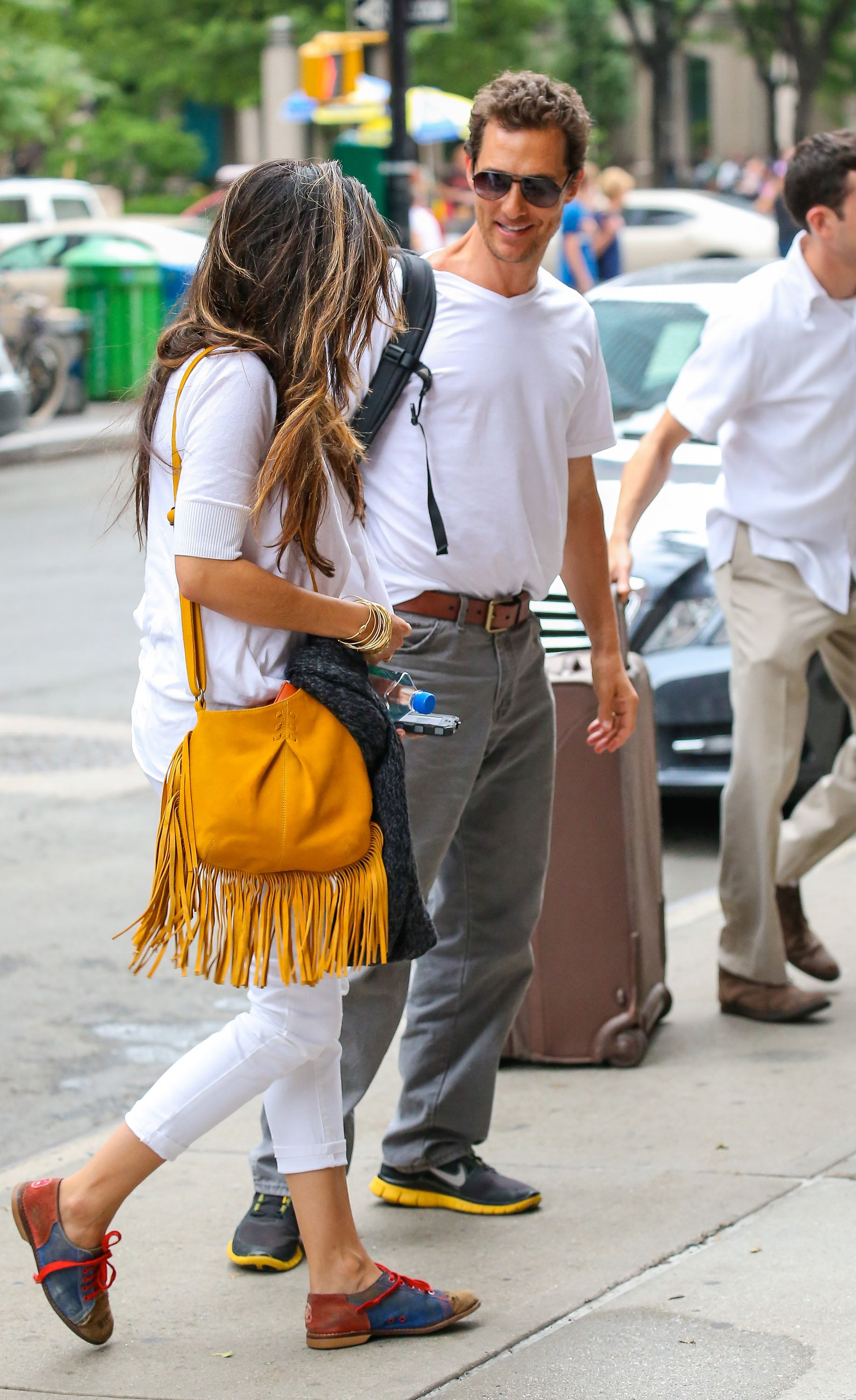 Matthew McConaughey and Camila Alves smiled at each other.