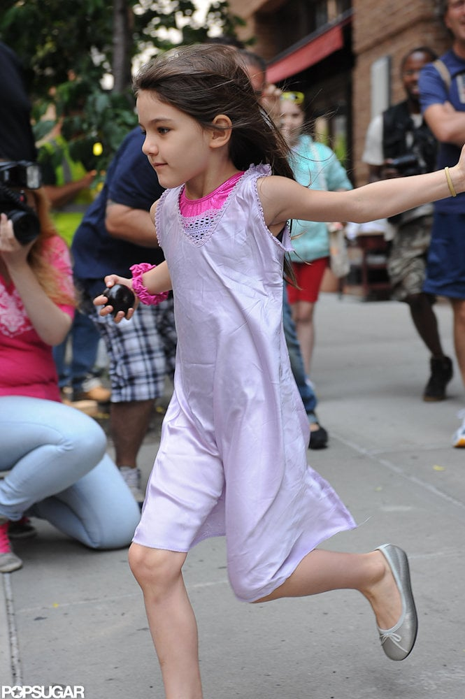 Suri Cruise ran in her silver flats for the car in NYC.