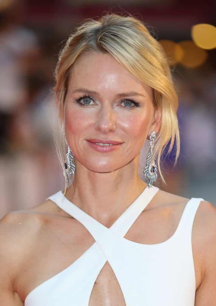 Naomi balanced her white cutout Versace dress with dewy makeup and a simply styled updo for the world premiere of Diana.