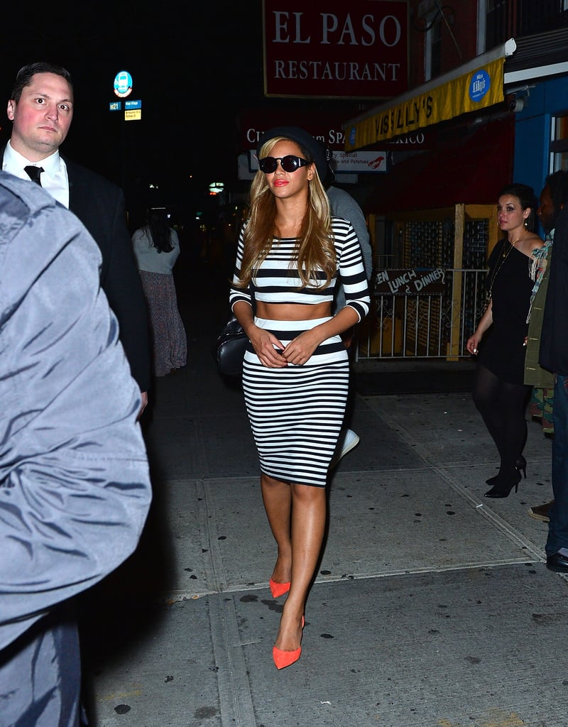 Beyoncé hit Kanye West's NYC birthday bash wearing a striped crop top with a matching pencil skirt, then added hot coral pumps for extra pizzazz.