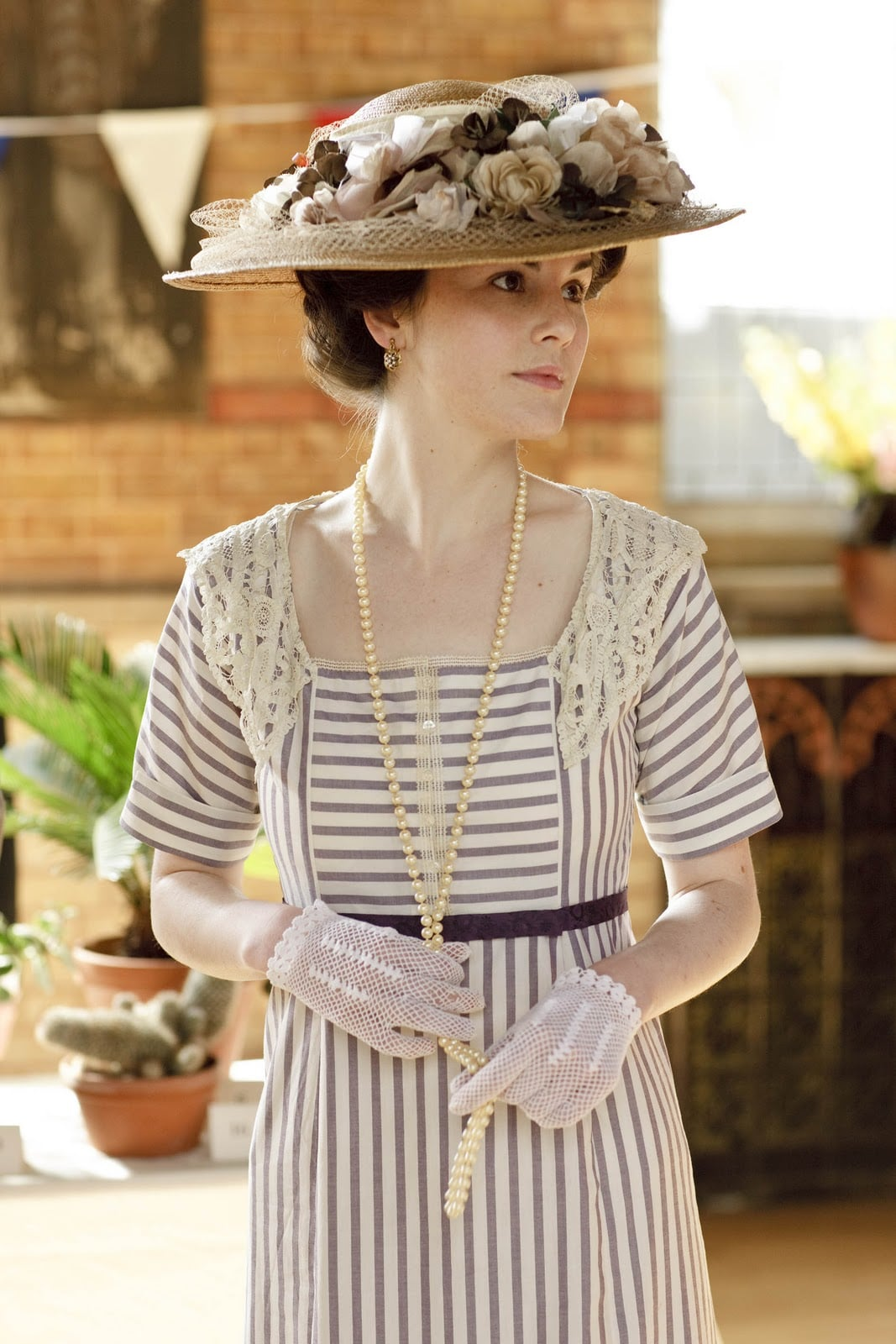 Hats, usually topped with flowers or feathers, were de rigueur during the Edwardian era.  Source: ITV