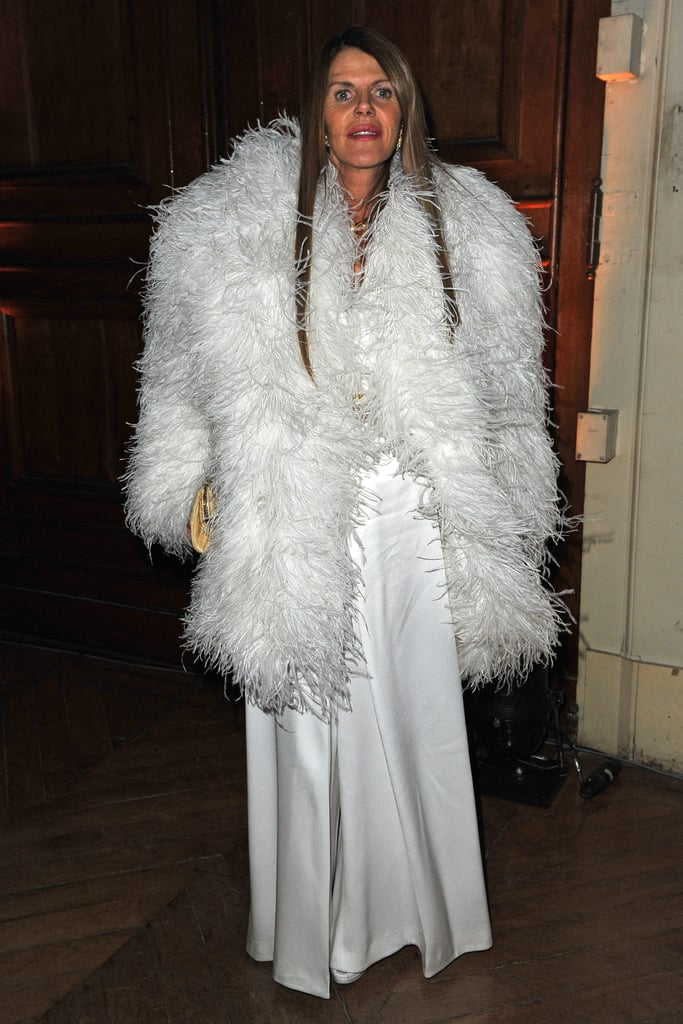 It was all about the all-consuming white feathered topper for Anna Dello Russo, who dressed up in her finest whites for Yves-Saint Laurent.
