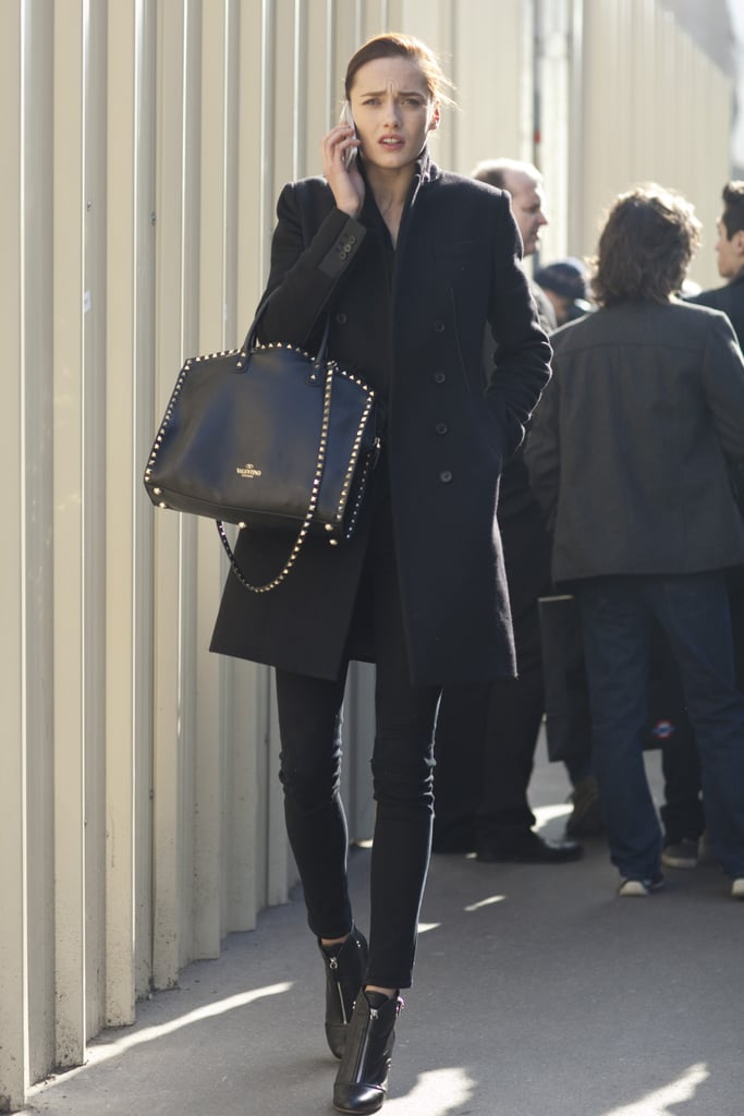 Tougher accents, like the studs on her Valentino bag and zippers on her boots, are the subtle details that made a big difference here.