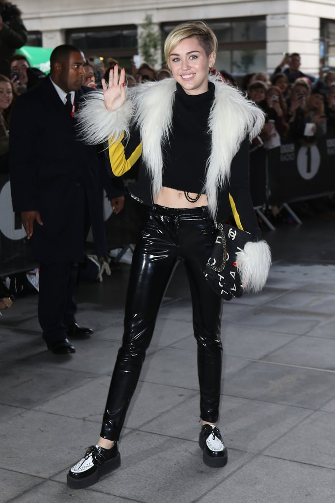 Nov. 12 was a patent leather and fur kind of day for the star, accessorizing her slick pants and fur-trimmed jacket with a lettered Chanel bag on her way to BBC Radio 1 in London.