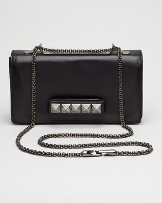 The bag: Valentino Noir VaVa Voom Flap Bag ($2,395) Why we love it: With a surge of celebs sporting these covetable little numbers as clutches and shoulder bags, we can't help but be smitten. First of all, it's a convertible bag (in case you didn't get that), so it's doubly versatile. Add to that the fact that its demure shape gets a cool-girl update with studs across the front, and you have the makings of one seriously sweet wardrobe essential.