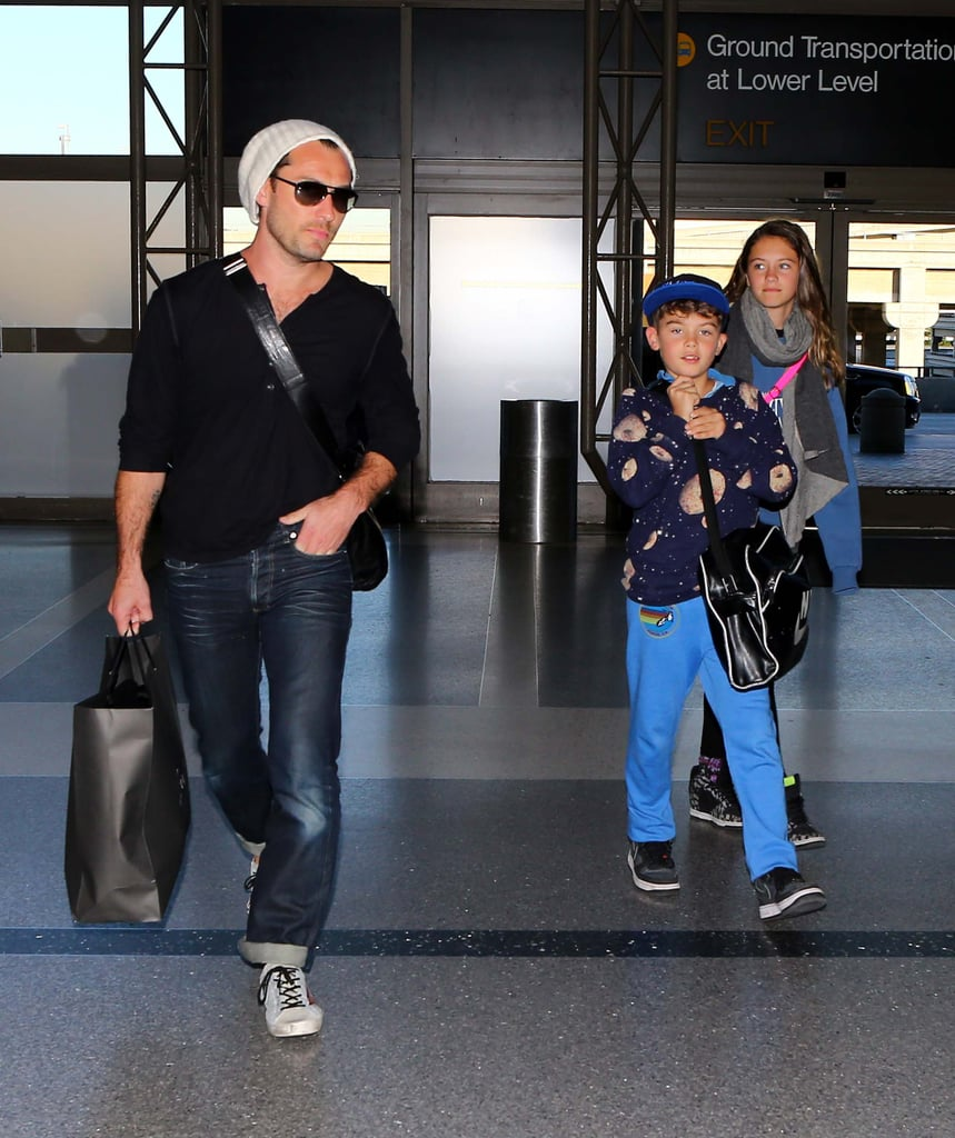 Jude Law and two of his children prepared to leave LA.
