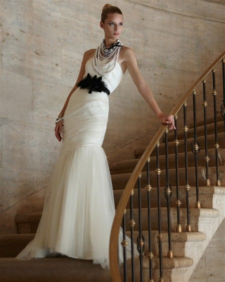 Equal parts sophisticated and all-out glam, opt to switch into this party gown for your dressiest of wedding parties.  The Victoria Bridal Gown ($300, originally $598)