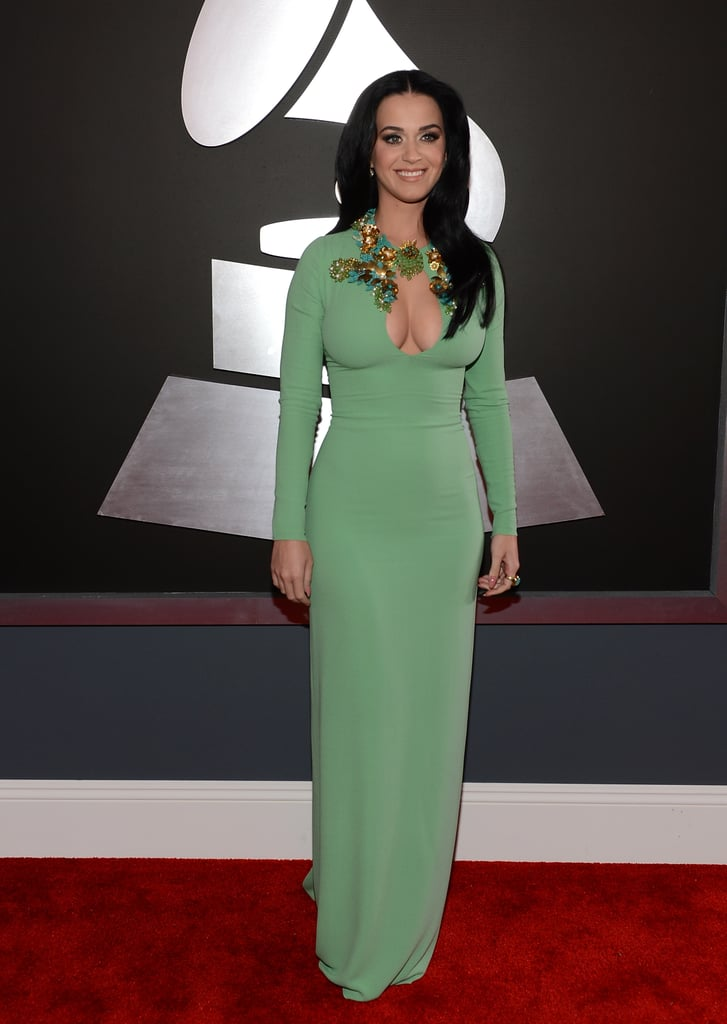 Katy Perry posed on the Grammys red carpet in a green Gucci gown.