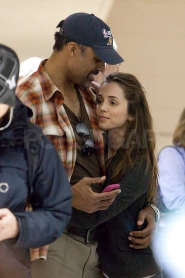 Pictures of Rick Fox and Eliza Dushku at LAX During the Holidays
