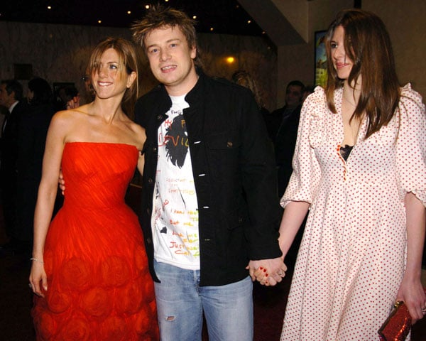As much a Hollywood celebrity as a chef, Jamie rubs elbows with the likes of Jennifer Aniston at movie premieres, like this London showing of Along Came Polly in February 2004.