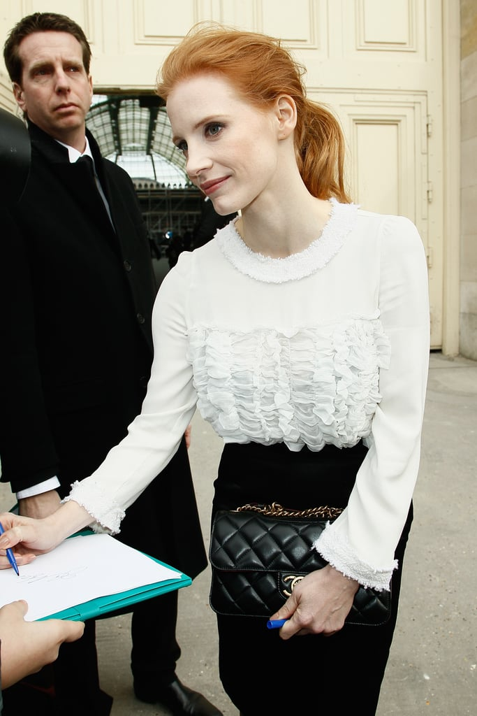While signing autographs outside the Chanel show, Jessica showed off her classic black quilted Chanel bag.