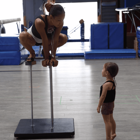 Mom Does Handstand With Daughter on Her Back