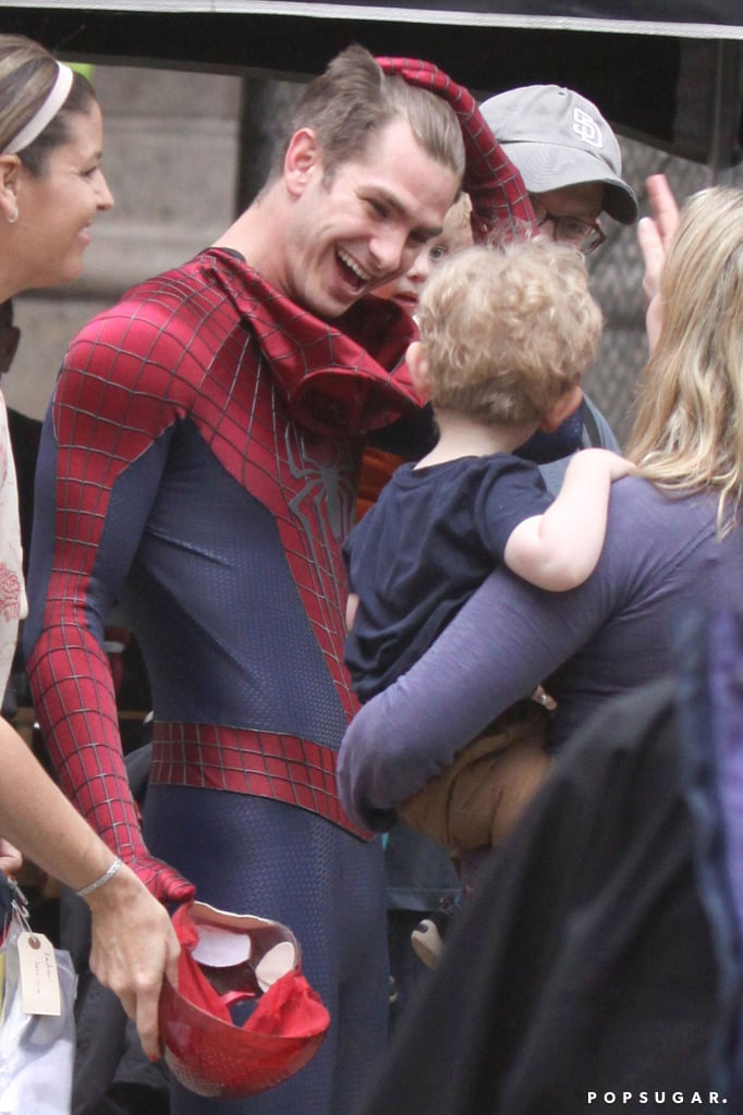 In NYC, Andrew Garfield gave a small fan a big smile on set.