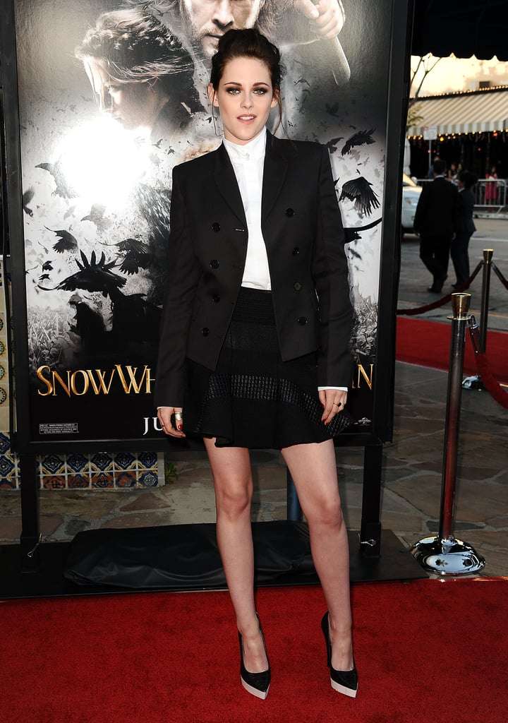 Kristen Stewart arrived on the LA red carpet in a playful riff on the classics — her head-to-toe Stella McCartney look was comprised of a white button-down, a fit-and-flare miniskirt, and a double-breasted blazer.