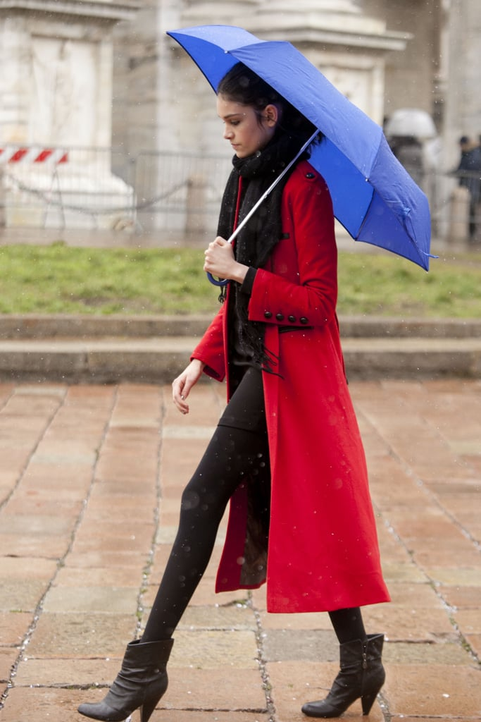 A bright cobalt umbrella happened to be the perfect accompaniment to this showgoer's brilliant red coat.