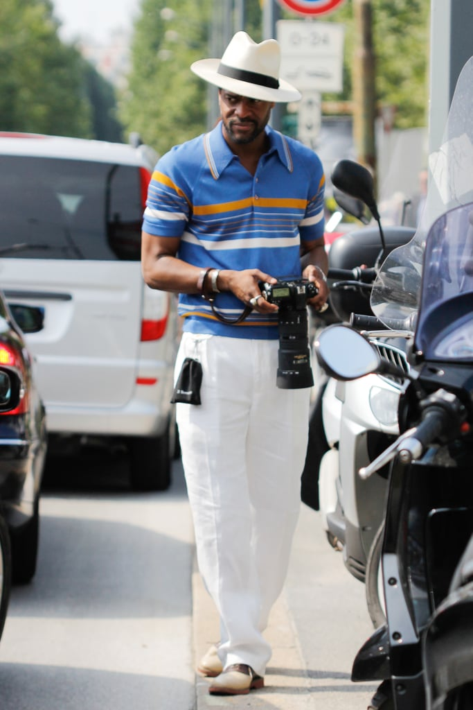 In Milan, the dress code trended toward chic Summer style. This gentleman completed his classic striped polo shirt and trousers with the perfect panama hat.