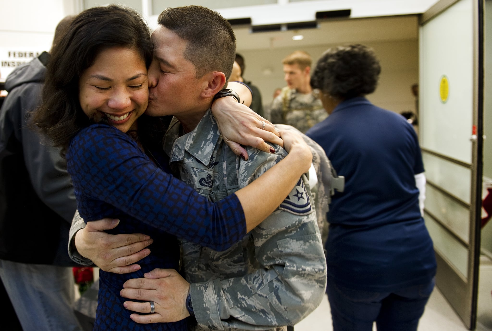 Tech Sgt. Cecilio Ricardo kissed his wife, Lalaine, when he arrived at Baltimore Washington International Airport in Baltimore on Dec. 20, 2011. He was a part of the last Air Force personnel group to return home from Iraq.