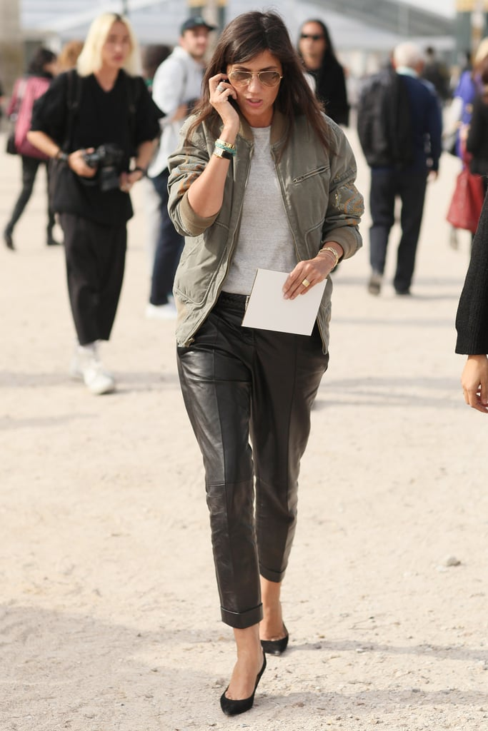 Emmanuelle Alt mixed leather trousers with a faded bomber for a cool-girl riff on aviator-inspired style (right down to her sunglasses).