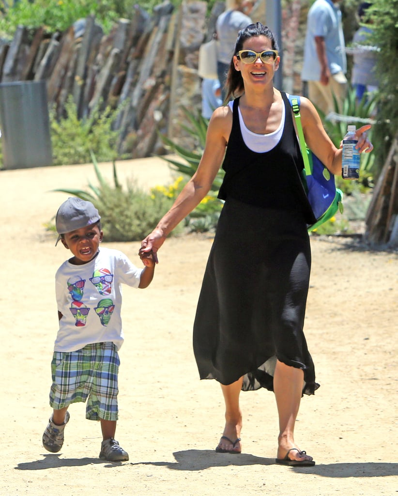 Sandra and Louis Bullock smiled during their day at the museum.