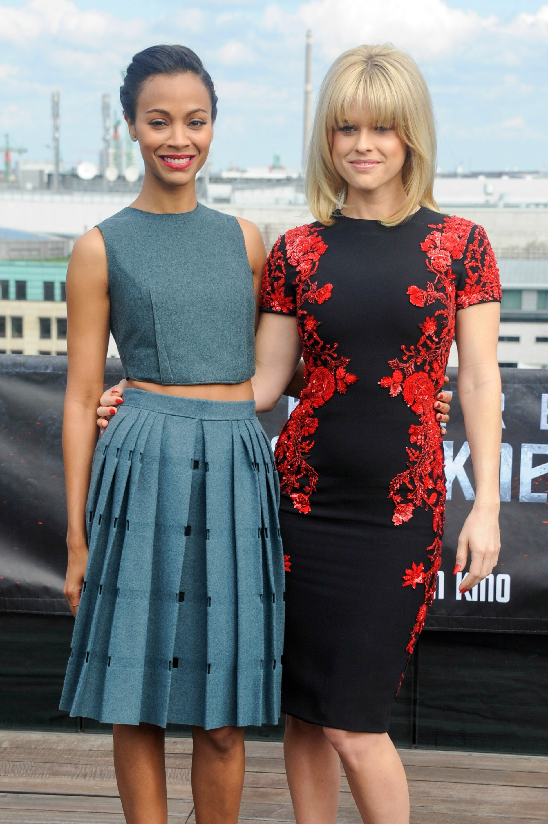A closer look at the costars' knee-length cocktail dresses. Zoe Saldana chose a Calvin Klein Fall '13 look, while Alice Eve went with something from Reem Acra's Fall '13 collection.