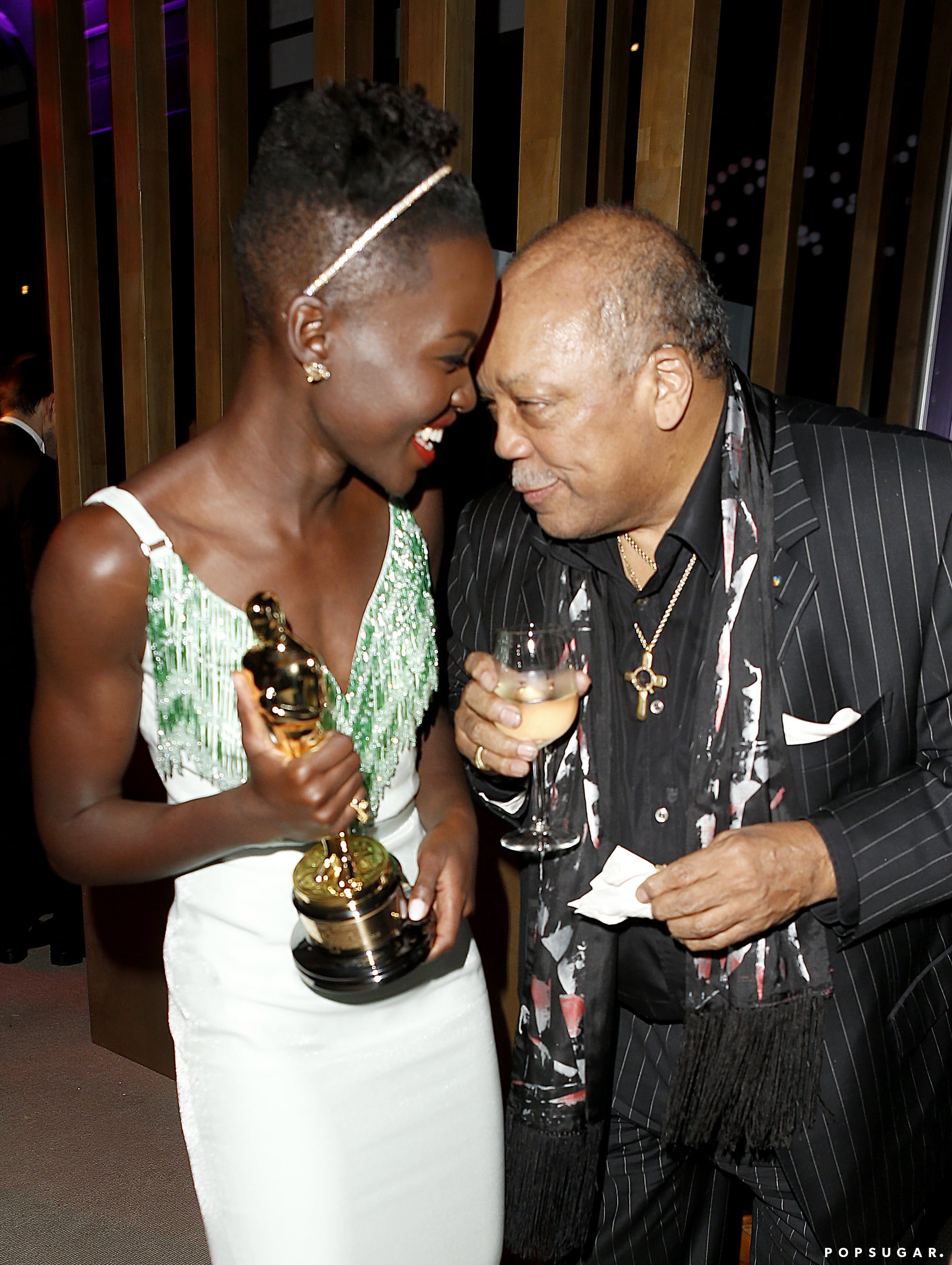 Lupita Nyong'o shared a winning moment with Quincy Jones at the Vanity Fair afterparty.