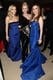 Naomi Watts was sandwiched between blue-dress beauties Reese Witherspoon and Isla Fisher at the Vanity Fair Oscar party on Sunday.