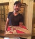 Forty minutes later, Guilherme arrived with the pizza.