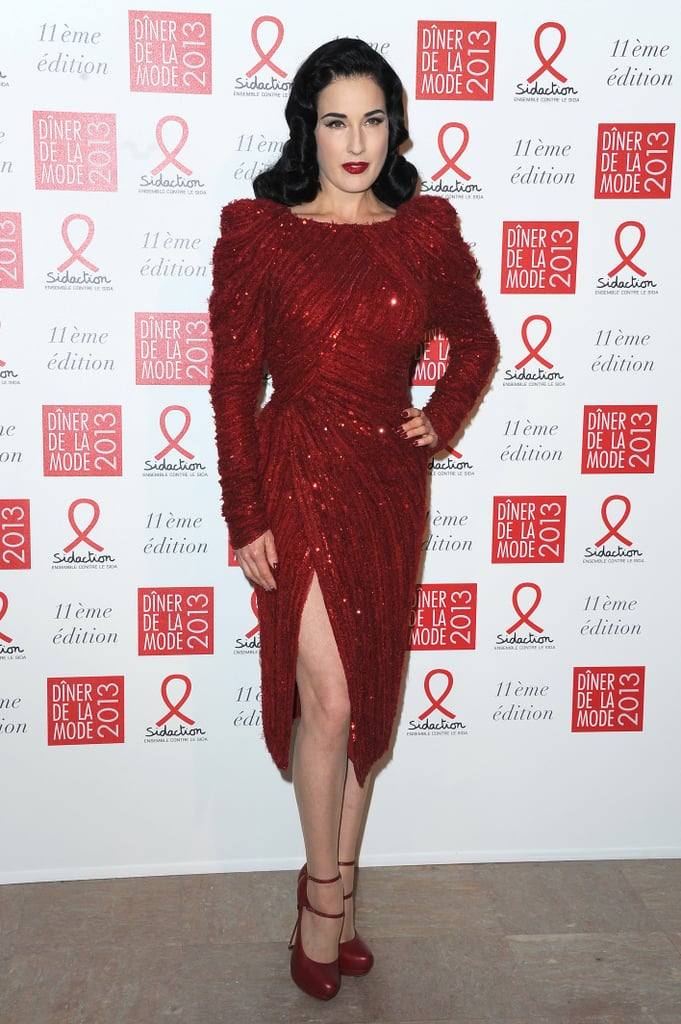 Dita Von Teese sparkled in a red thigh-split cocktail dress at the Sidaction Gala. Her matching red lip and double-strap pumps put the extra siren spin on this eye-catching look.