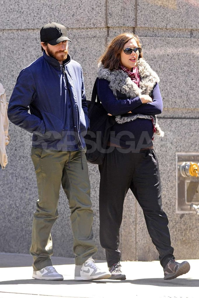 Jake Gyllenhaal took a walk with pregnant sister Maggie Gyllenhaal around NYC.