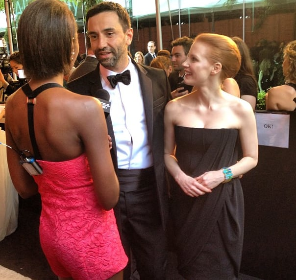 Riccardo Tisci and Jessica Chastian — in a black draped column gown — chat on the carpet.  Source: Instagram user styledotcomrachel