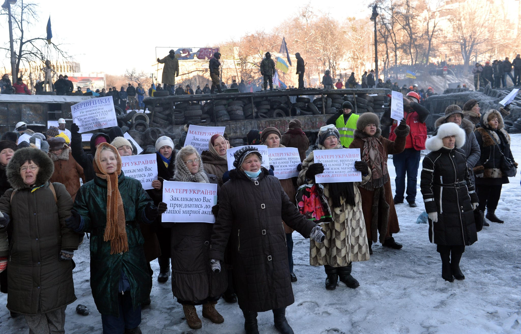 Women gathered with signs asking the police to join the protest.