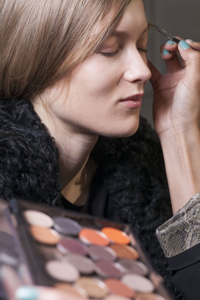 """Lead makeup artist Diane Kendal for MAC decided along with Victoria """"to just make the girls look beautiful and polished."""" Here's a look at her makeup table backstage."""