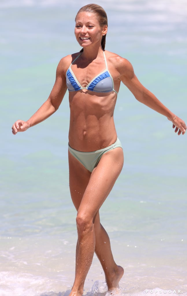 Kelly's flat tummy was on display during a day in the ...
