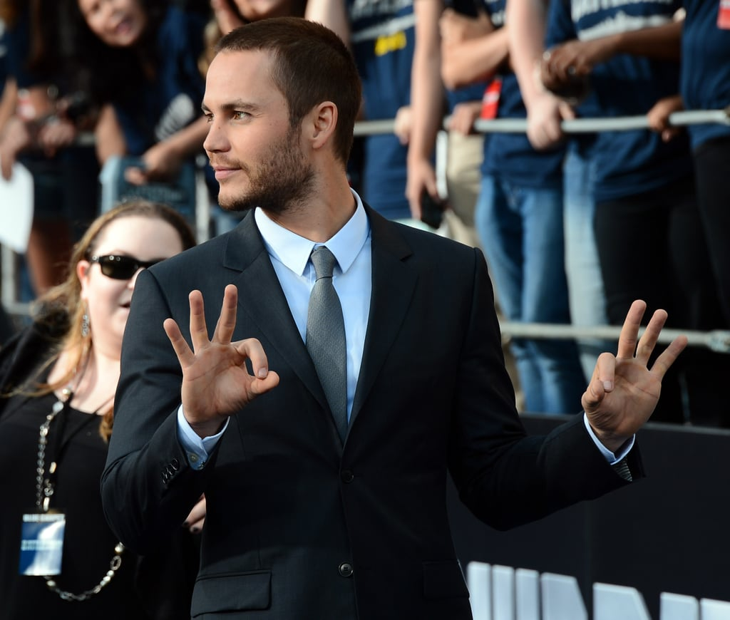 Taylor Kitsch stepped onto the blue carpet for the premiere of Battleship in LA.