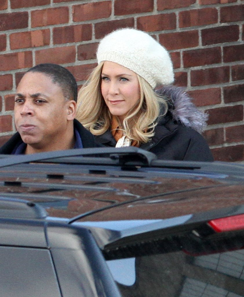 Jennifer Aniston wore a white beret over her blond wig on set.