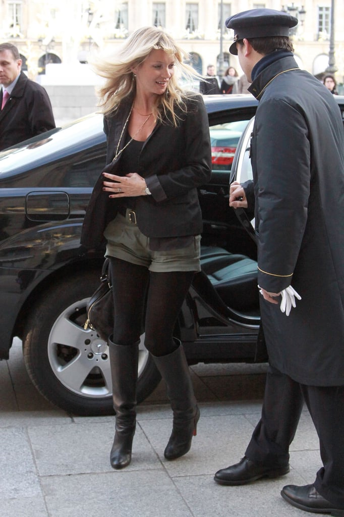 Kate Moss's street style is something worth emulating, this time with a pair of tailored shorts over black tights.