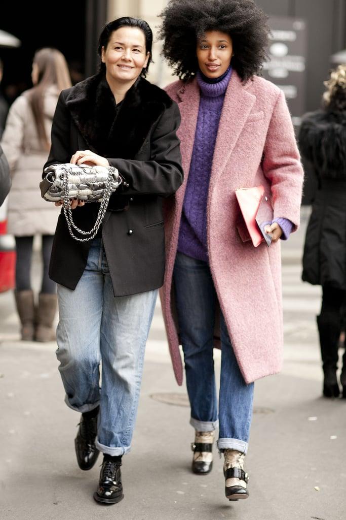 Julia Sarr-Jamois bundled up in pastel layers alongside a showgoer working a more under-the-radar black coat and boyfriend jeans.
