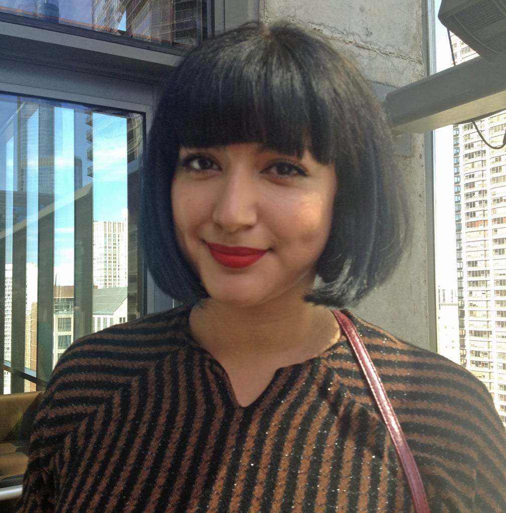MAC Cosmetics Senior Artist Cynthia Rivas rocked a bright, matte red lip, a striking accompaniment to her jet-black bob and blunt bangs.