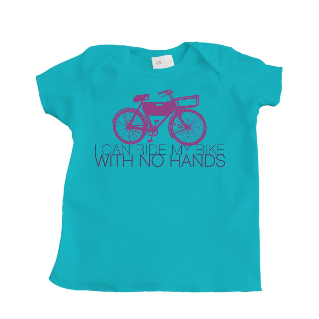 """For a playful pick, help your kid announce her feat to the world with this silly """"I can ride my bike with no hands"""" shirt ($10)."""