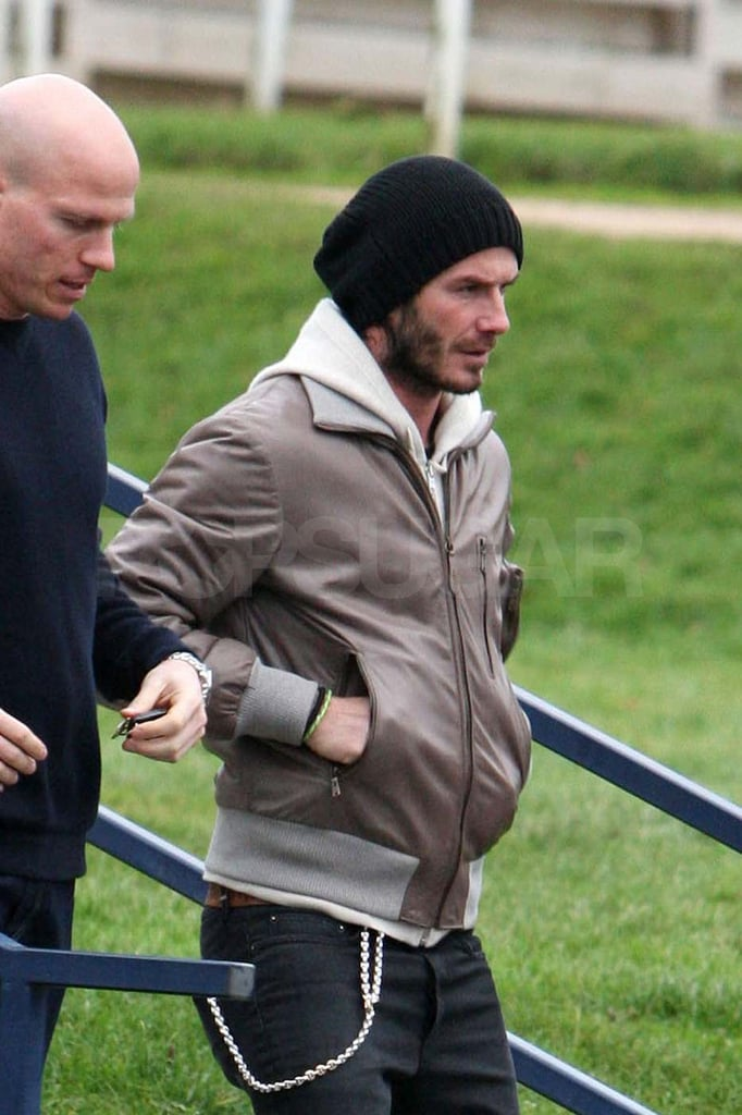 David Beckham Stops to Help a Stranger While Posh Prepares For Fashion Week