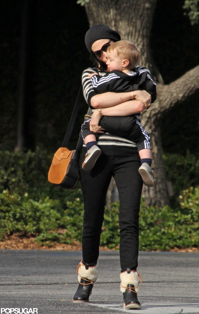 January Jones held baby Xander tight during an LA outing.