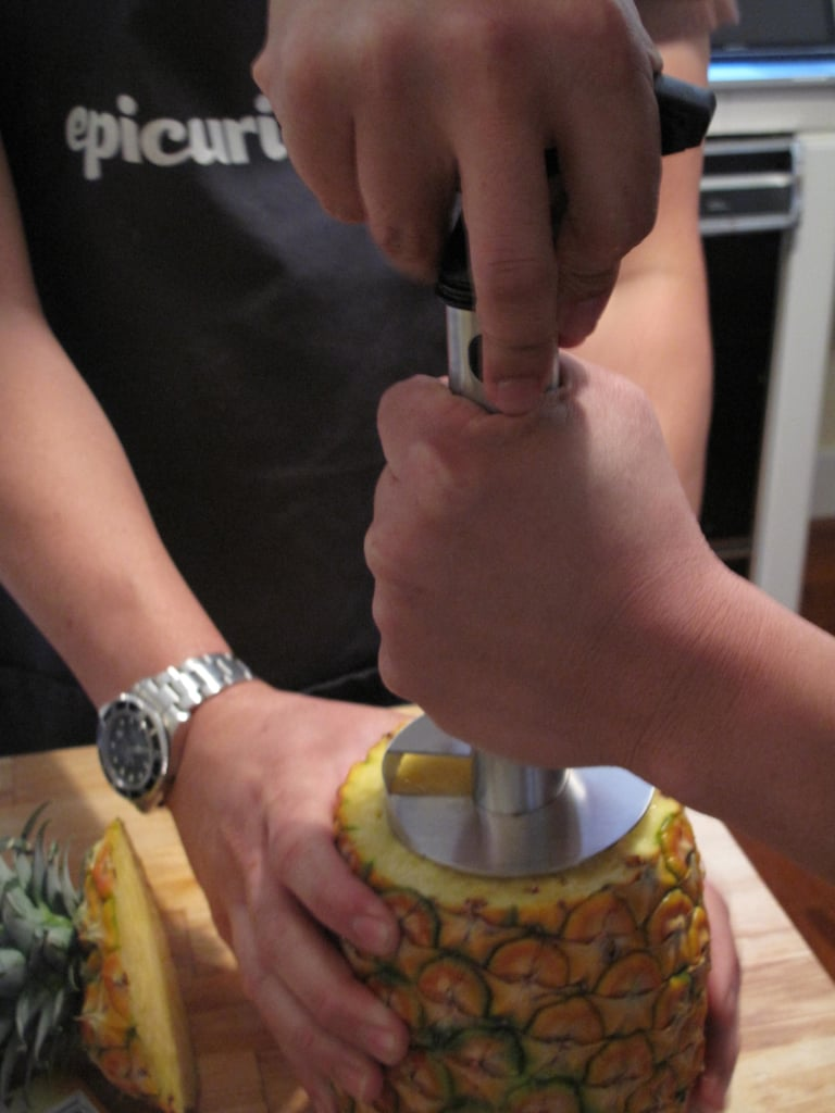 Insert the pineapple slicer, serrated blade facing down.