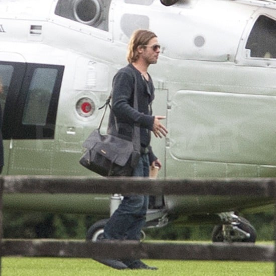 Brad Pitt had only a few bags on his arrival in Richmond, England.